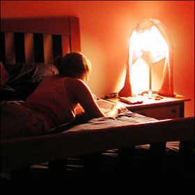 woman_writing_diary_on_bed_280